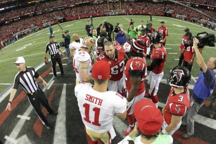 Referee Terry McAulay and back judge Tony Steratore prepare for the coin toss (San Francisco 49ers photo)