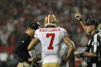 Line judge Tom Stephan indicates a timeout is ending to 49ers quarterback Colin Kaepernick and coach Jim Harbaugh. (San Francisco 49ers photo)