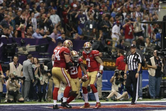 Wrolstad keeping an eye on the 49ers during a touchdown celebration (San Francisco 49ers photo)