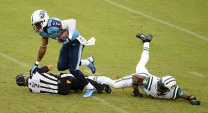 Billy Smith during a collision with Titans receiver Nate Washington [Donn Jones/Tennessee Titans]
