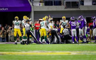 Walt Anderson's crew uncovers the ball (Green Bay Packers)