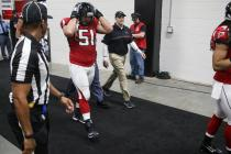 Julian Mapp escorts the Falcons onto the field (Atlanta Falcons)