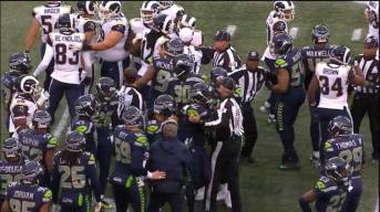 Ed Hochuli crew breaks up a fight