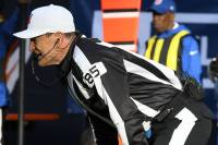 Ed Hochuli. Note the ear piece on his radio.