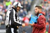 Ed Hochuli looks at a replay review