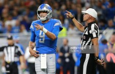 DETROIT, MI - SEPTEMBER 23: Referee Clete Blakeman #34 makes a call as Matthew Stafford #9 of the Detroit Lions reacts during the first quarter against the New England Patriots at Ford Field on September 23, 2018 in Detroit, Michigan. (Photo by Rey Del Rio/Getty Images)