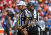 LANDOVER, MD - SEPTEMBER 16: Referee Clete Blakeman (34) and umpire Ramon George (128) walk up the field on September 16, 2018, at FedEx Field in Landover, MD. The Indianapolis Colts defeated the Washington Redskins, 21-9. (Photo by Mark Goldman/Icon Sportswire via Getty Images)