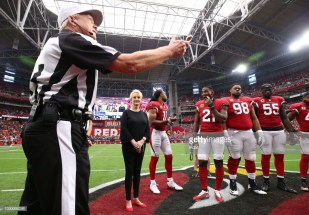 Walt Coleman tosses the coin (Photo by Rob Schumacher-Pool/Getty Images)