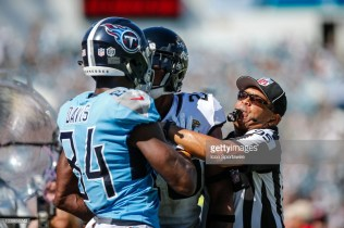 JACKSONVILLE, FL - SEPTEMBER 23: Side judge James Coleman breaks up a confrontation between Jacksonville Jaguars cornerback Jalen Ramsey (20) and Tennessee Titans wide receiver Corey Davis (84) during the game between the Tennessee Titans and the Jacksonville Jaguars on September 23, 2018 at TIAA Bank Field in Jacksonville, Fl. (Photo by David Rosenblum/Icon Sportswire via Getty Images)
