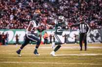 Umpire Ruben Fowler tosses the flag (New York Jets)