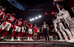 Brad Allen flips the coin. (Atlanta Falcons)