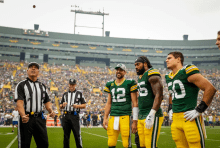 Referee John Hussey flips the coin. (Green Bay Packers)