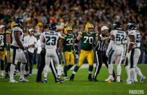 A partially obscured Jerod Phillips and referee Clay Martin (Green Bay Packers)