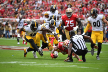 Ramon George falls backwards as the Steelers and 49ers scramble after a fumble. (Pittsburgh Steelers)