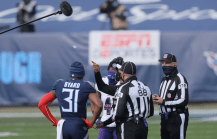 Brad Freeman and Mike Weatherford watch referee Jerome Boger flip the coin. (Baltimore Ravens)
