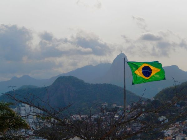 The Power of the Brazilian Passport -Brazil flag above Rio