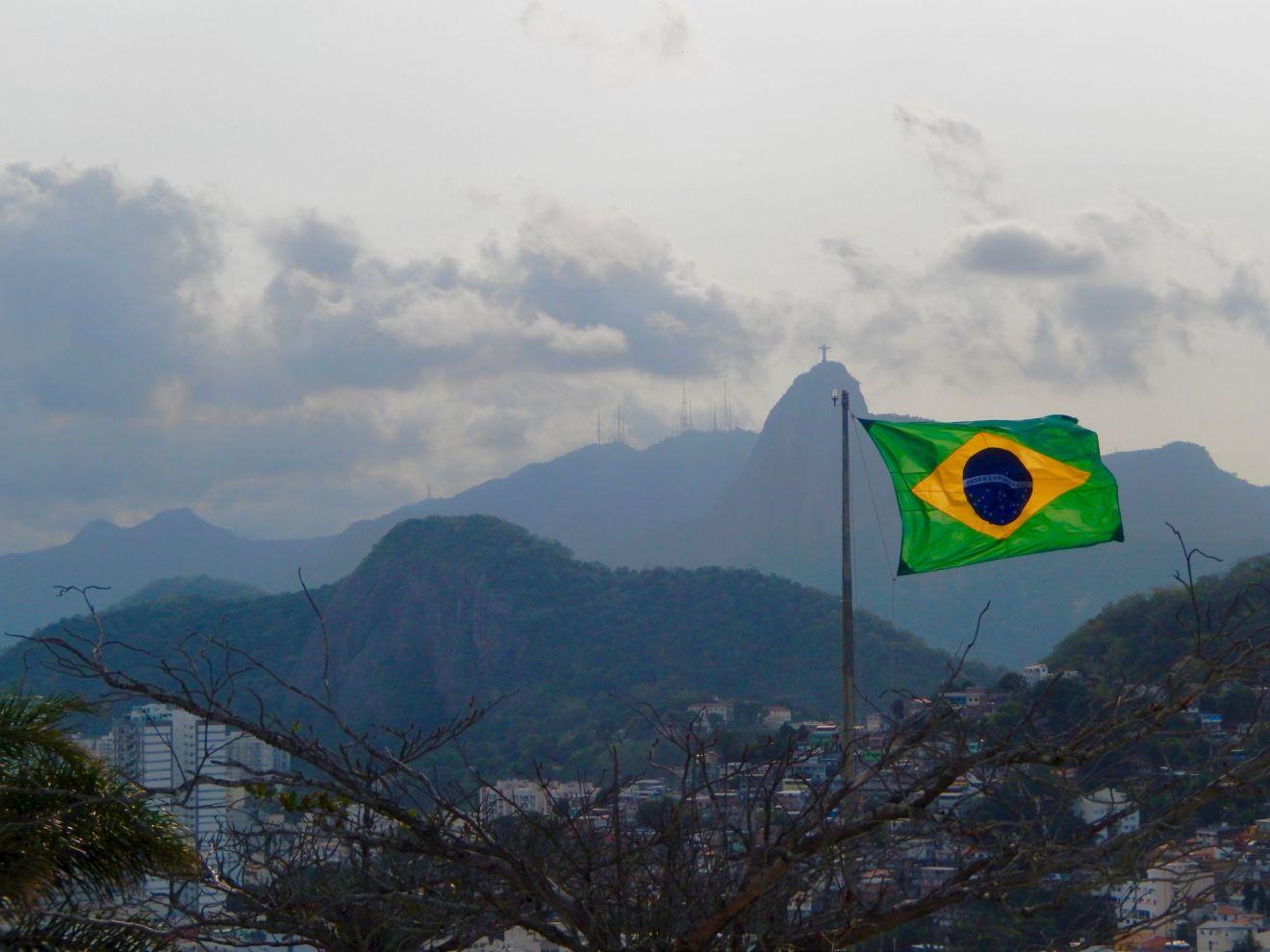 The Power of the Brazilian Passport -Brazil flag above Rio