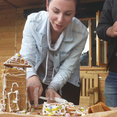 Woman making a Ginger Bread house