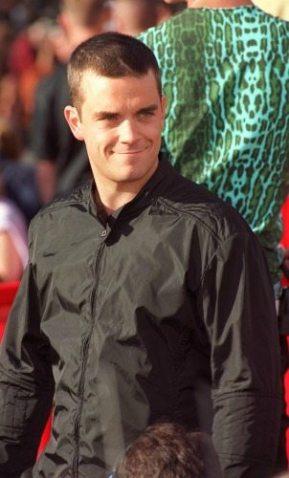 Robbie Williams nel 1999 | © Dan Callister / Getty Images