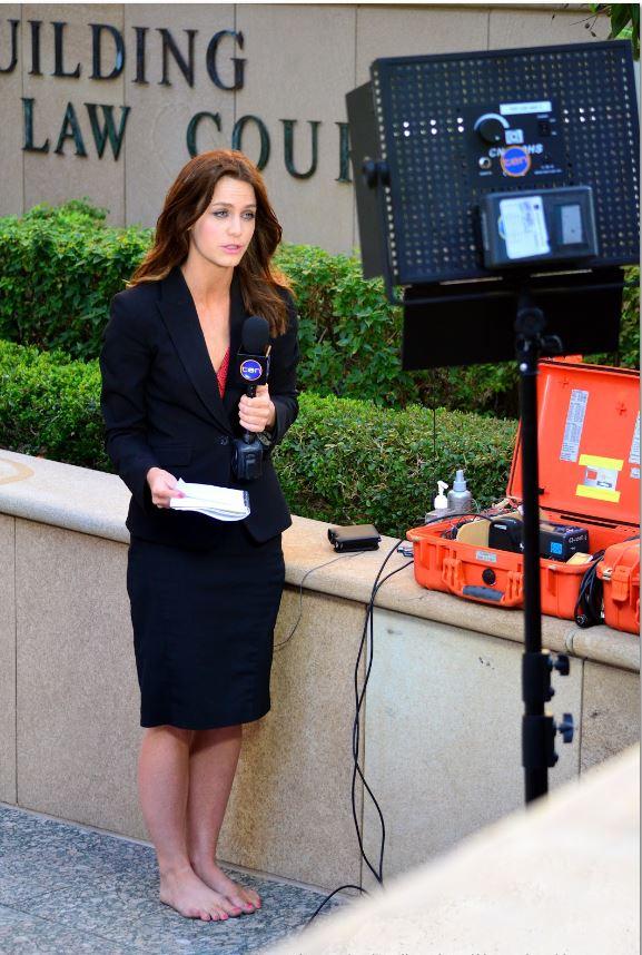 aussie news reporter barefoot 3.JPG