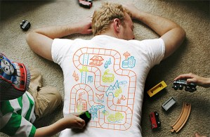 LAZY PARENTING AT ITS BEST: Playmat Back Massage T-Shirt Let's You Get Some Quality Time With Your Kids Without You Having to Be Conscious