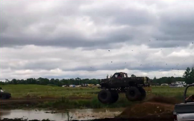 Ford Jumping into Mud Pit