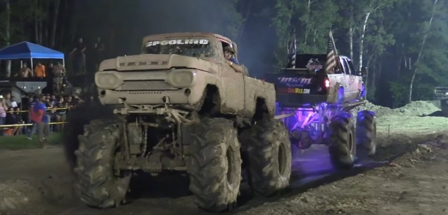 Antique Ford Tugs Against Chevy