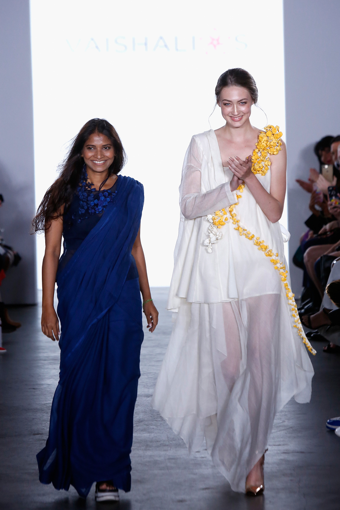 NEW YORK, NY - SEPTEMBER 08: Designer Vaishali Shadangule and model walk the runway for Vaishali S SS2018 - Runway - New York Fashion Week: First Stage at The Gallery at The Dream Downtown Hotel on September 8, 2017 in New York City.