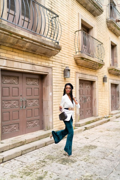 black women street style velvet flare pants on a budget, gold coin statement belt white blazer ring handbag