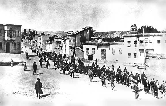 Armenians are marched to a nearby prison in Mezireh by armed Turkish soldiers. Kharpert, Armenia, Ottoman Empire, April, 1915 (Public Domain/Wikimedia Commons)