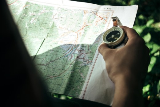 leśnik z mapą i kompasem. Forester with map and compas