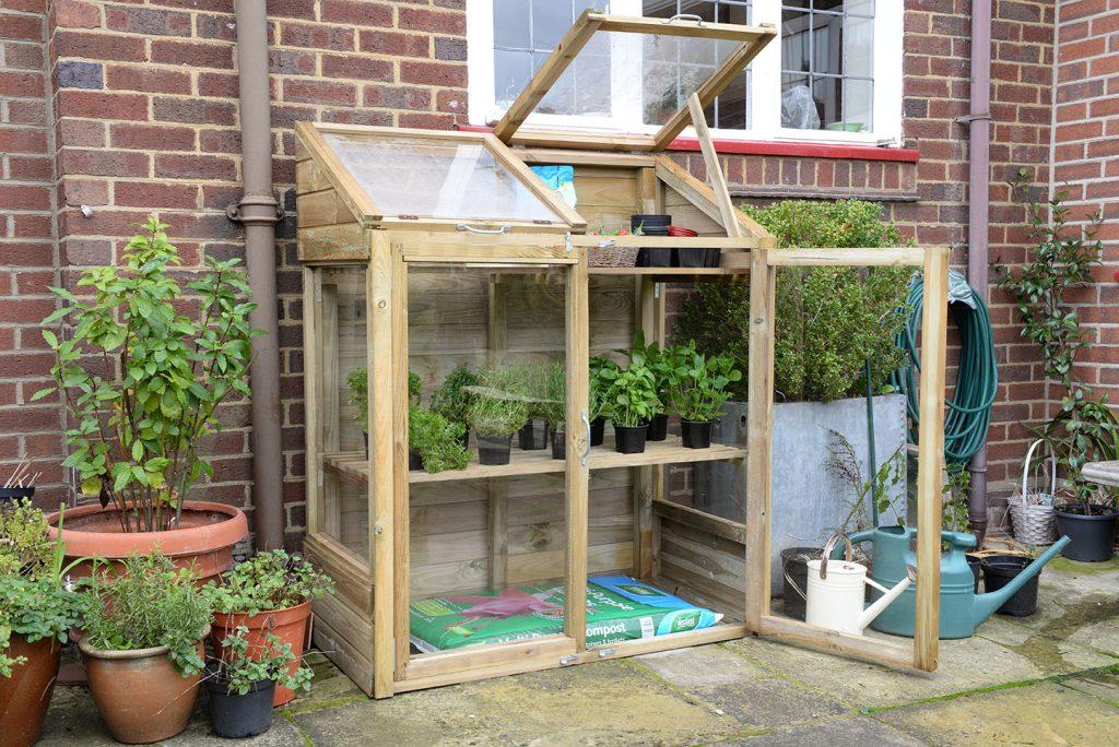 mini greenhouse forest garden