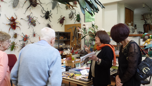 During the May 2014 art walk, Joan Danziger, second from the right, explains some of her work to guests.