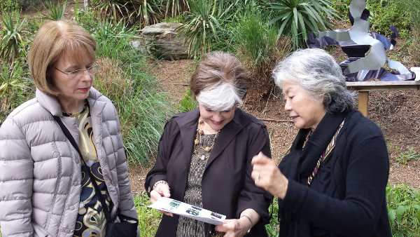 Setsuko Ono, right, with visitors at the 2014 Art Walk.
