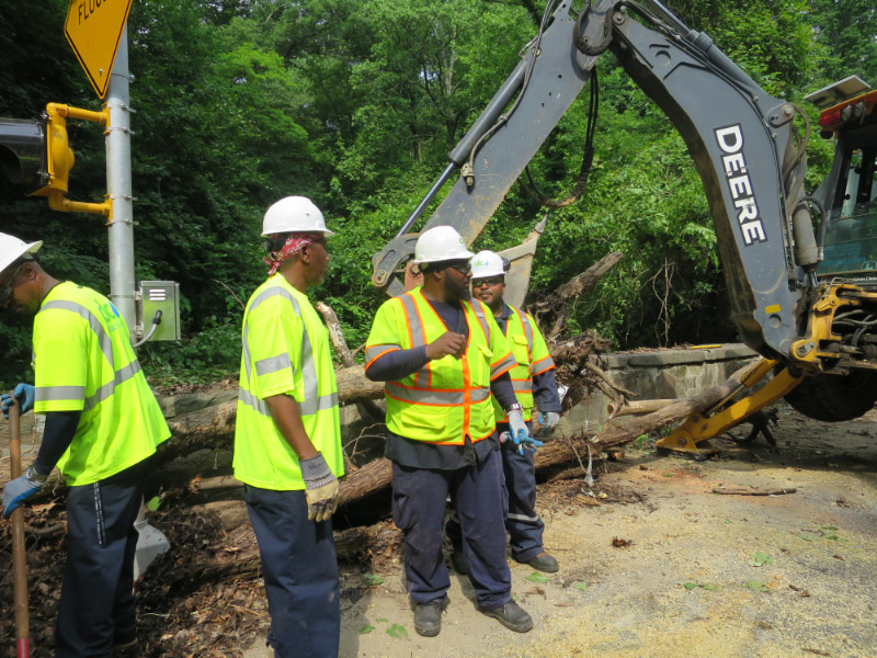 DC Water's inlet and outlet cleaning crew is headed by Vincent Sims (center).