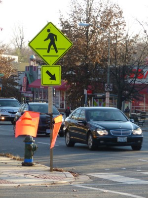 The orange flags pedestrians once used to get cars to stop at the Northampton Street crosswalk have been replaced by a HAWK signal.