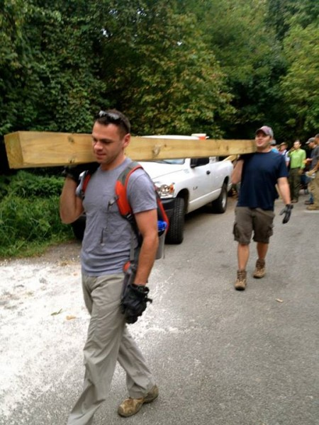 Devin Rhinerson, back, and Mike Leyva carry a railroad tie/water bar. (photo courtesy of the Potomac Appalachian Trail Club)