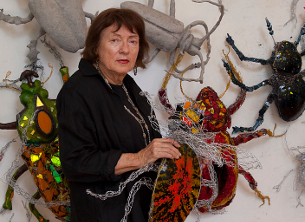 Joan Danziger in her studio with her beetles.