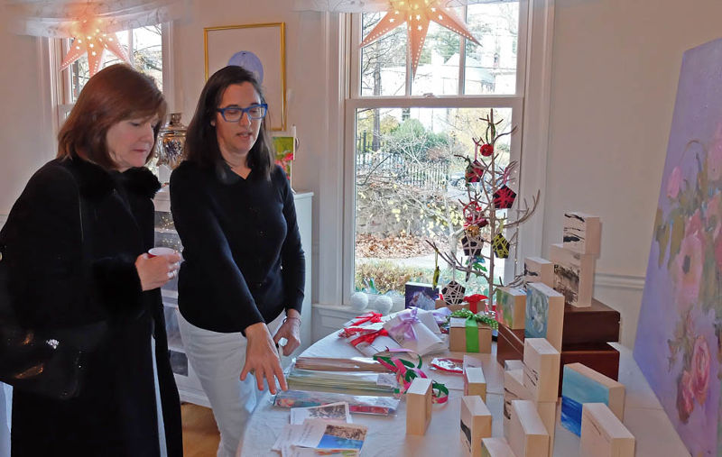 Michelle Muri-Sloane, right, explains her work at the Dec. 3 Forest Hills Holiday Bazaar. (photo courtesy of Phil Taplin)
