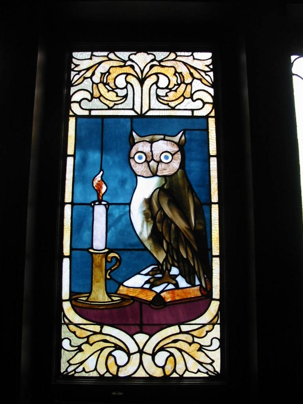 This stained glass window in the foyer was part of the original home and preserved in the restoration.