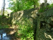 Historic bridge at 36th and Nevada, bricked up and Broad Branch Stream piped underneath