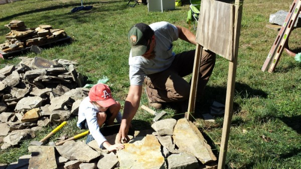 Demonstrating how to build a stone wall using nothing but gravity, friction and an eye for detail.