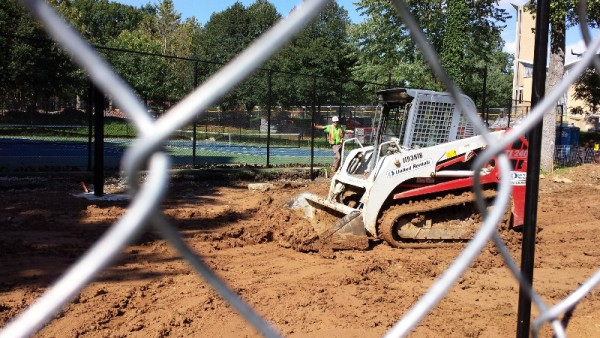 Digging in the new half court/seating area south of the Forest Hills tennis courts.