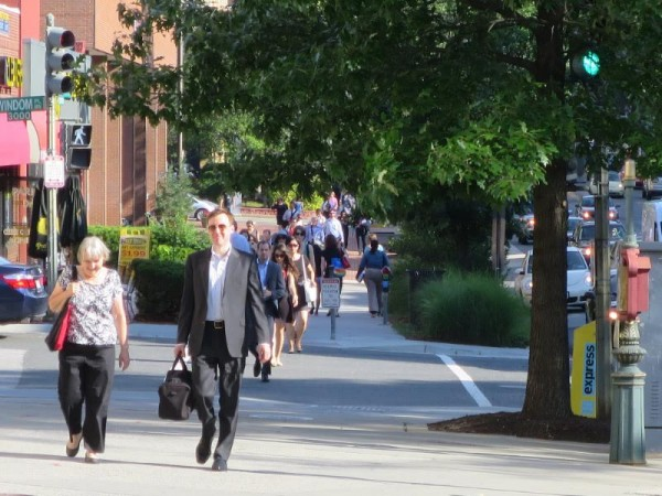 A steady stream of pedestrians headed south on the west side of Connecticut Avenue.