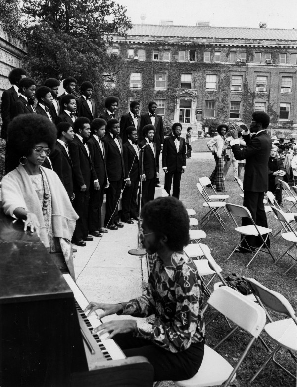 A choir performs at WTI's graduation ceremony in 1974. WTI held its commencement south of Van Ness Street until the new campus's Quadrangle was ready later in the 1970s. (photo from HBCU Library Alliance)