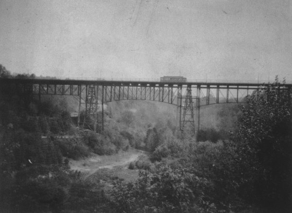 The Rock Creek Bridge was built at Calvert Street by the Rock Creek Railway Company in 1891-92 to span the steep Rock Creek Valley. The Duke Ellington Bridge replaced it in 1934 (Library of Congress photo)