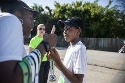 First-time runners receive a medal from the event on Saturday, Aug. 3, during the annual Miles 4 Missions Run and Walk outside of Living Word Christian Center on Roosevelt Road in Forest Park. | ALEXA ROGALS/Staff Photographer