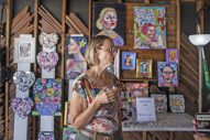 Rose Mattax, the host at 540 Ferdinand Avenue, talks with guests and artists on Saturday, Aug. 24, 2019, during the annual Garage Galleries throughout Forest Park | ALEXA ROGALS/Staff Photographer