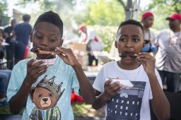 Joah McGee, left, and Justin Scott, both from Forest Park, eat ribs together on Saturday, Sept. 7, 2019, during Forest Park's annual Ribfest at The Grove on Madison Street. | Photo by Alex Rogals