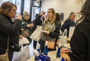 Participants sample different types of wine on Nov. 2, during the annual Fall Wine Walk and Shop event at Takara in downtown Forest Park, Ill. | ALEX ROGALS/Staff Photographer